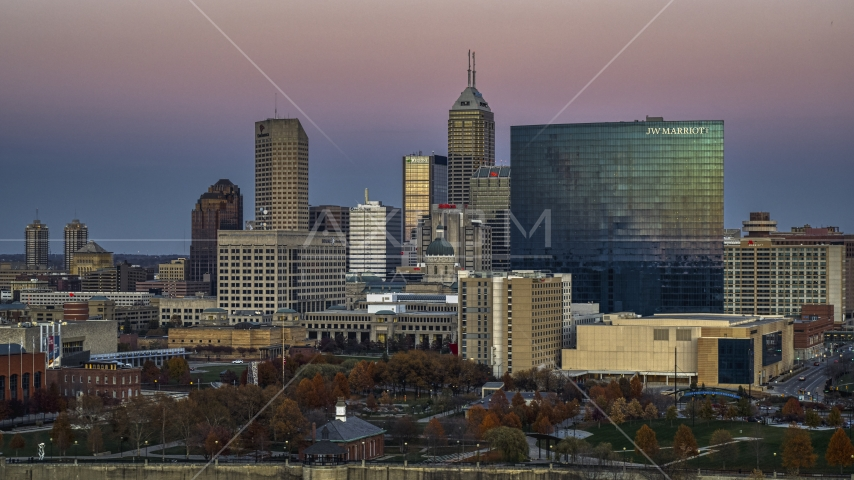 The city's tall skyline and a hotel at sunset in Downtown Indianapolis, Indiana Aerial Stock Photos | DXP001_092_0020