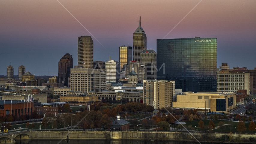 The city's towering skyline and a hotel at sunset in Downtown Indianapolis, Indiana Aerial Stock Photos | DXP001_092_0021
