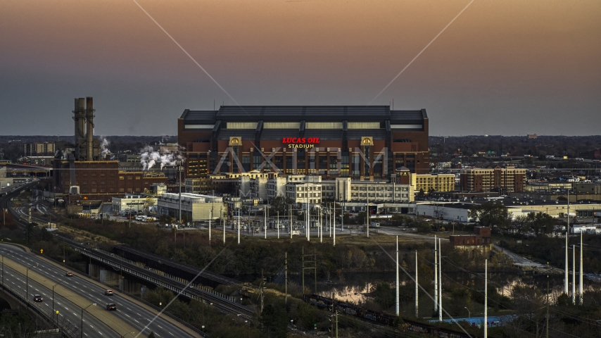 The side of a football stadium at sunset, Downtown Indianapolis, Indiana Aerial Stock Photos | DXP001_092_0022