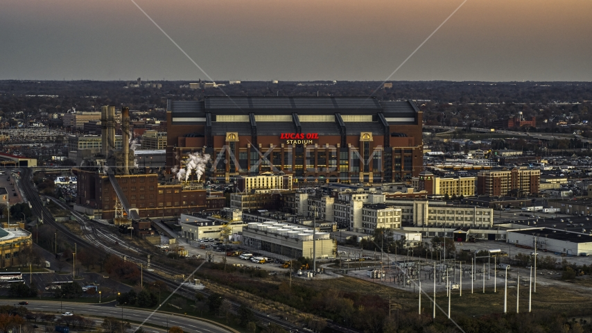 A view of the side of a football stadium at sunset, Downtown Indianapolis, Indiana Aerial Stock Photos | DXP001_092_0023