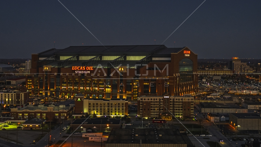The football stadium at twilight in Indianapolis, Indiana Aerial Stock Photos | DXP001_093_0004