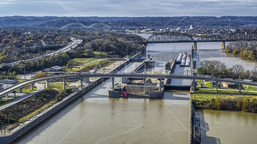 A view of locks and a dam on the Ohio River in Louisville, Kentucky Aerial Stock Photos | DXP001_094_0013