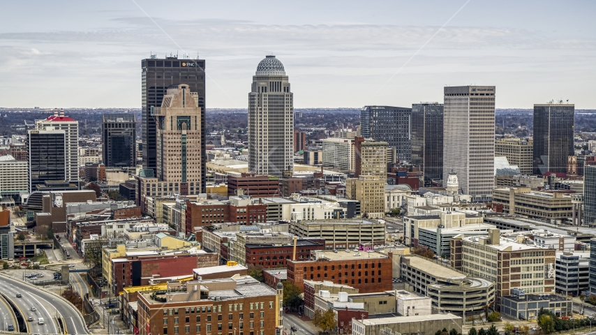 City skyline seen from brick buildings in Downtown Louisville, Kentucky Aerial Stock Photos | DXP001_095_0001