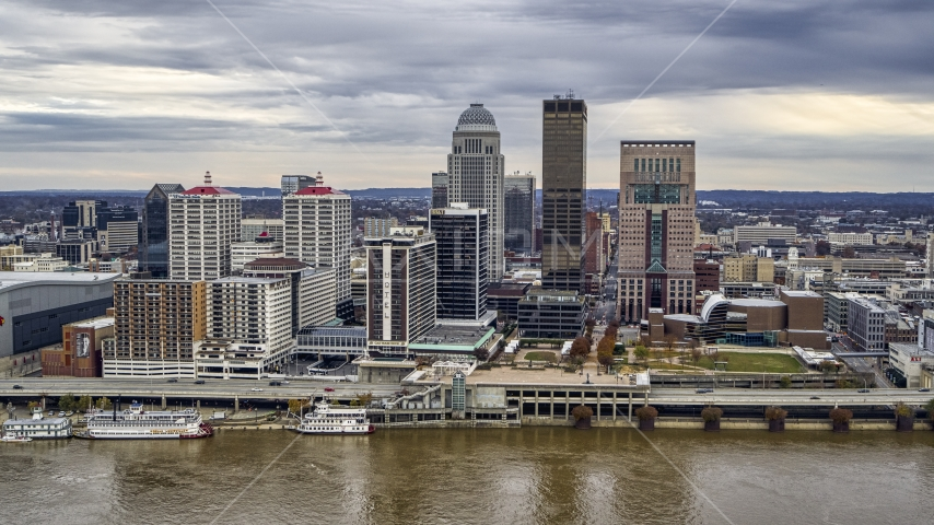 Hotel and the skyline from the Ohio River in Downtown Louisville, Kentucky Aerial Stock Photo DXP001_095_0012 | Axiom Images