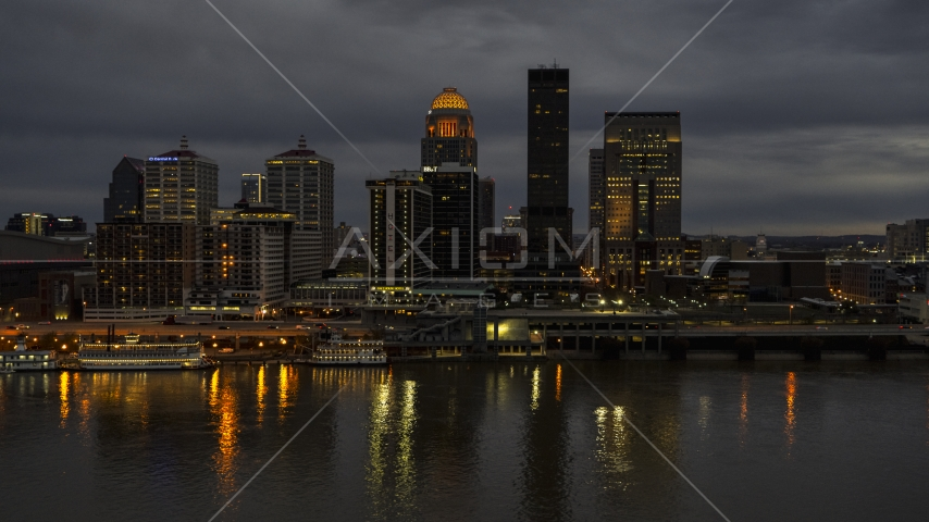 Tall skyscrapers lit up for the night in Downtown Louisville, Kentucky Aerial Stock Photos | DXP001_096_0013