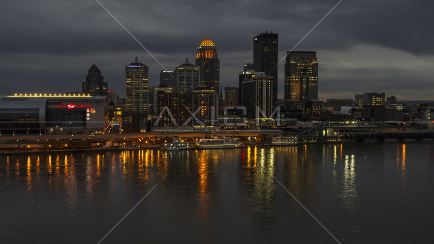 A view of the skyline lit up at twilight, seen from Ohio River, Downtown Louisville, Kentucky Aerial Stock Photos | DXP001_096_0014