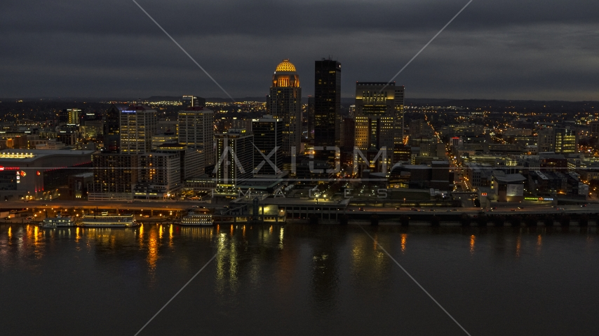 The city's skyline at twilight, seen from Ohio River, Downtown Louisville, Kentucky Aerial Stock Photos | DXP001_096_0015