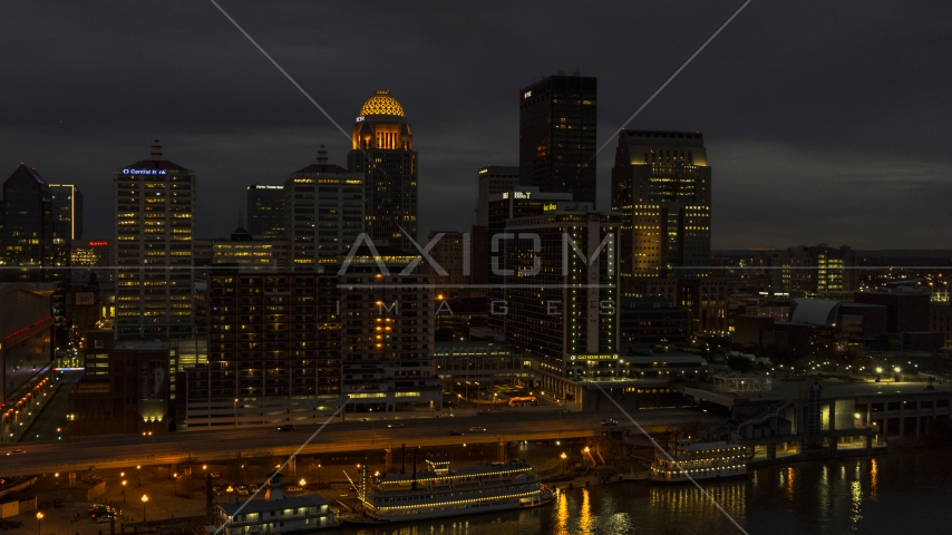 A view of hotel and the city skyline at twilight beside the river, Downtown Louisville, Kentucky Aerial Stock Photos | DXP001_096_0016