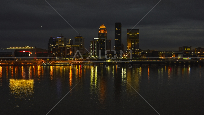 A view across the Ohio River toward the city skyline at twilight, Downtown Louisville, Kentucky Aerial Stock Photos | DXP001_096_0018