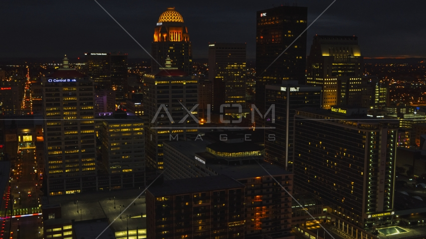 Tall buildings in the city's skyline lit up at twilight, Downtown Louisville, Kentucky Aerial Stock Photos | DXP001_096_0022