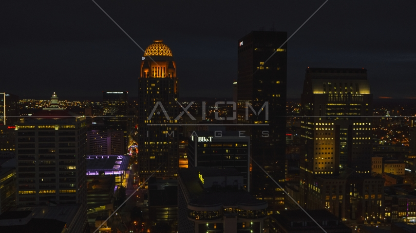Towering skyscrapers lit up at twilight, Downtown Louisville, Kentucky Aerial Stock Photos | DXP001_096_0023