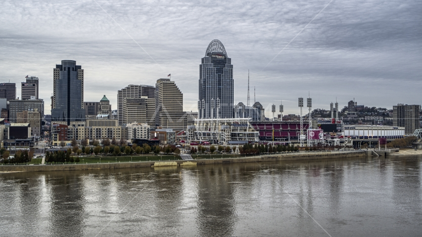 A view of the baseball stadium and skyscraper from the river, Downtown Cincinnati, Ohio Aerial Stock Photos | DXP001_097_0001