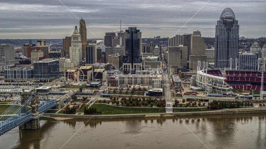 The Ferris wheel and city skyline seen from the Ohio River, Downtown Cincinnati, Ohio Aerial Stock Photos | DXP001_097_0006