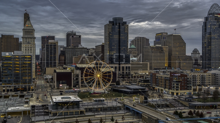 The Ferris wheel and the city skyline at sunset, Downtown Cincinnati, Ohio Aerial Stock Photos | DXP001_097_0010