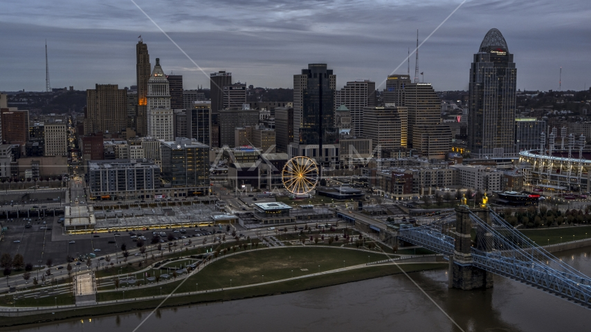 The city skyline's skyscrapers at sunset, seen from Ohio River, Downtown Cincinnati, Ohio Aerial Stock Photos DXP001_097_0012 | Axiom Images