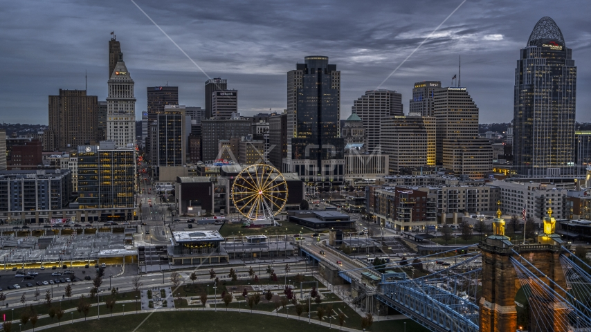 The city skyline and the Ferris wheel at sunset, Downtown Cincinnati, Ohio Aerial Stock Photos | DXP001_097_0013