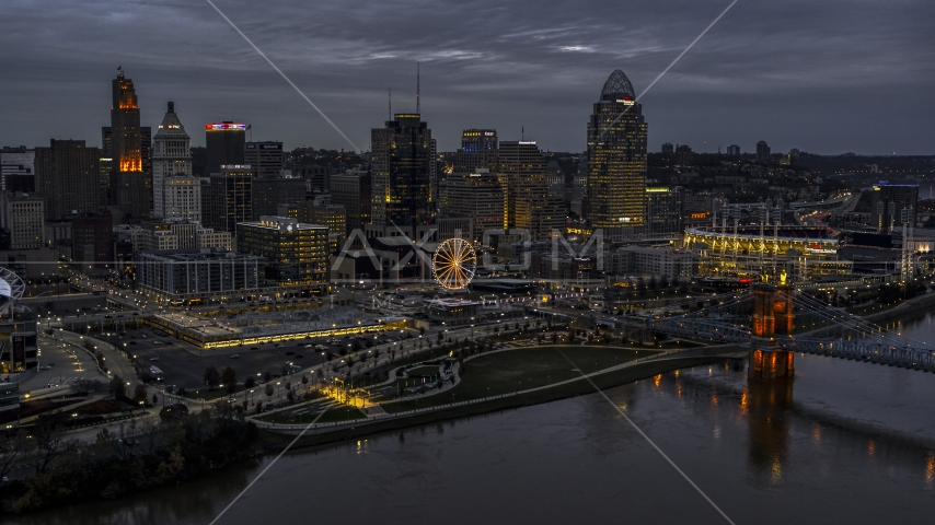 The city skyline and bridge lit for twilight, seen from Ohio River, Downtown Cincinnati, Ohio Aerial Stock Photos | DXP001_098_0001