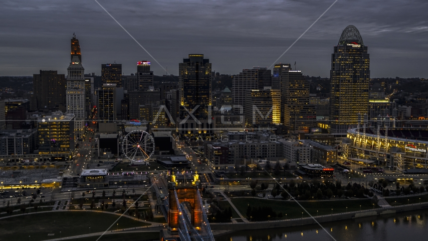 City skyline and the end of the bridge lit for twilight, Downtown Cincinnati, Ohio Aerial Stock Photos | DXP001_098_0002