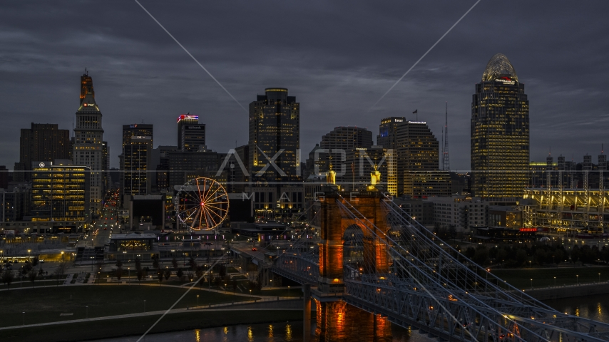 Roebling Bridge and city skyline lit up at twilight, Downtown Cincinnati, Ohio Aerial Stock Photos | DXP001_098_0005