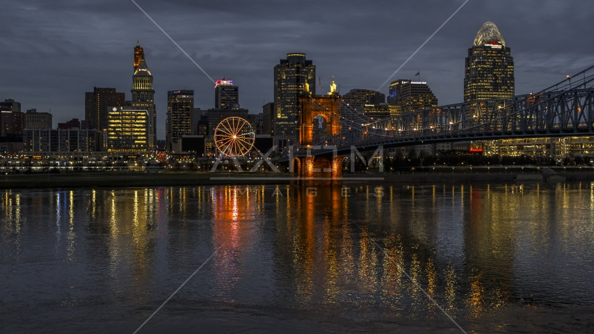 The city skyline across the Ohio River at twilight, Downtown Cincinnati, Ohio Aerial Stock Photos | DXP001_098_0011