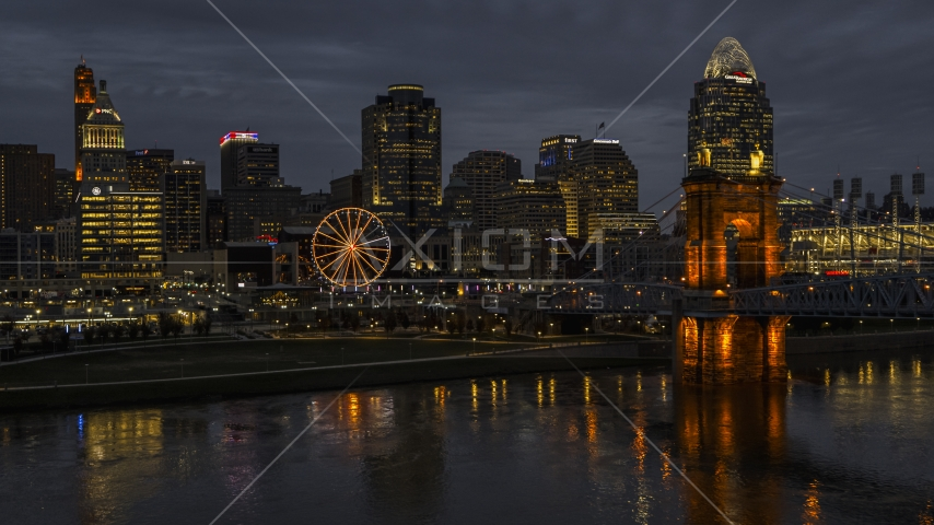 Skyscraper and Ferris wheel at twilight, seen from the Ohio River, Downtown Cincinnati, Ohio Aerial Stock Photos | DXP001_098_0012