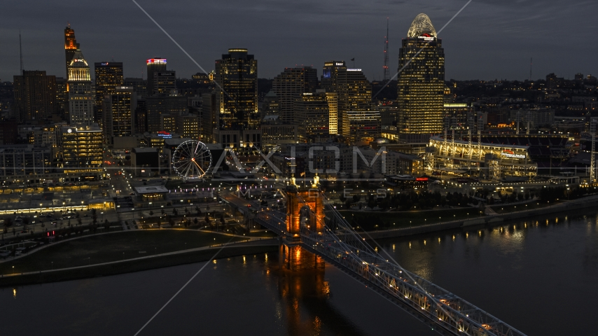 The city skyline at twilight, seen from river near bridge, Downtown Cincinnati, Ohio Aerial Stock Photos | DXP001_098_0013