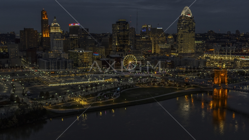 Ferris wheel and skyscrapers at twilight seen from the river, Downtown Cincinnati, Ohio Aerial Stock Photos   DXP001_098_0014
