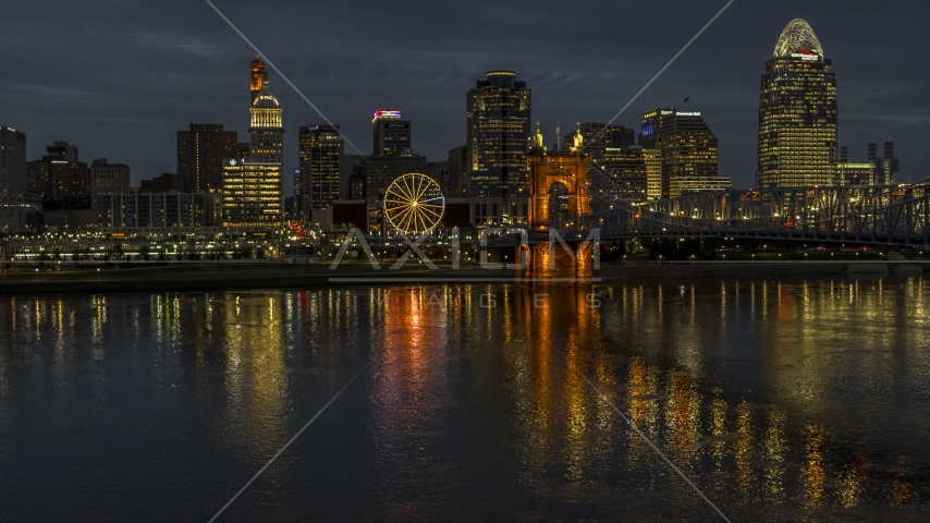 The city's skyline across the Ohio River at twilight, Downtown Cincinnati, Ohio Aerial Stock Photos | DXP001_098_0015