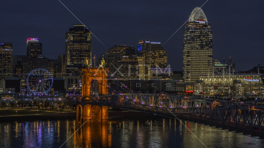 The Roebling Bridge at night and the city skyline, Downtown Cincinnati, Ohio Aerial Stock Photos | DXP001_098_0017