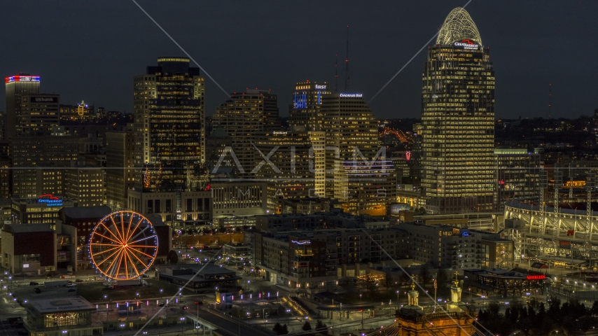 Tall skyscrapers and Ferris wheel at night in Downtown Cincinnati, Ohio Aerial Stock Photos | DXP001_098_0018