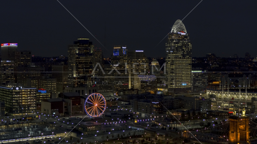 A view of the city skyline and Ferris wheel at night, Downtown Cincinnati, Ohio Aerial Stock Photos DXP001_098_0020