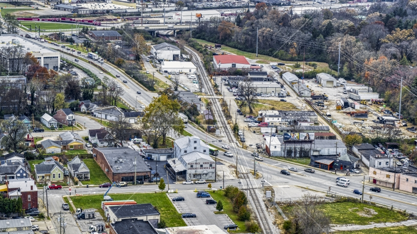 A busy street and railroad tracks in industrial area in Lexington, Kentucky Aerial Stock Photos | DXP001_099_0010