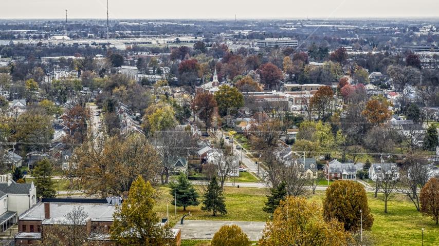 A church steeple behind suburban neighborhood in Lexington, Kentucky Aerial Stock Photos | DXP001_099_0014