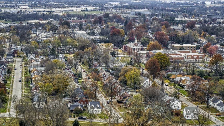 A church steeple and a tree-lined suburban neighborhood in Lexington, Kentucky Aerial Stock Photos | DXP001_099_0015
