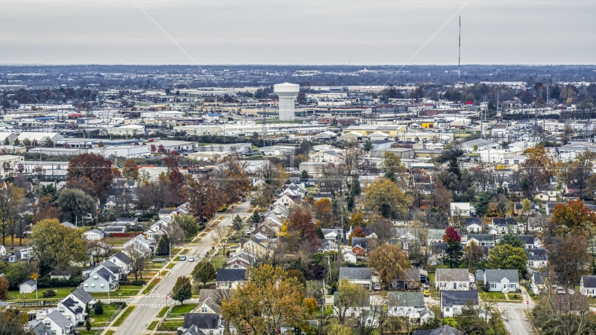 Homes with view of a water tower surrounded by warehouses in Lexington, Kentucky Aerial Stock Photos | DXP001_099_0017