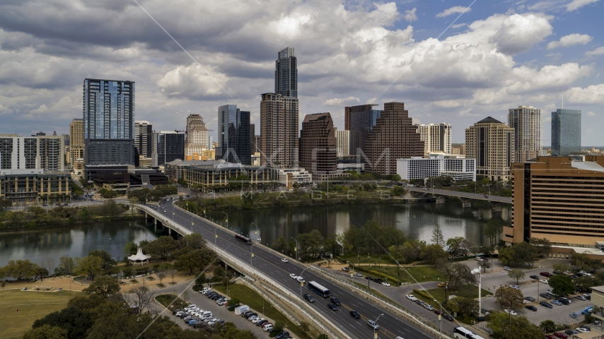 The city's skyline seen from First Street Bridge and Lady Bird Lake, Downtown Austin, Texas Aerial Stock Photos | DXP002_102_0001