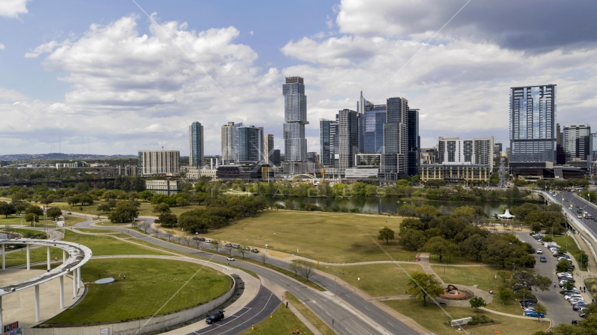A view of the city skyline across Lady Bird Lake in Downtown Austin, Texas Aerial Stock Photos | DXP002_102_0010