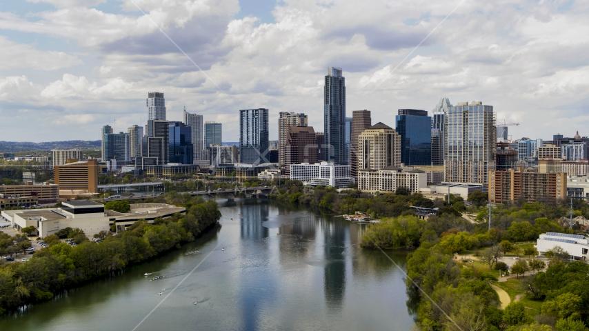The city skyline from Lady Bird Lake, Downtown Austin, Texas Aerial Stock Photos | DXP002_102_0017