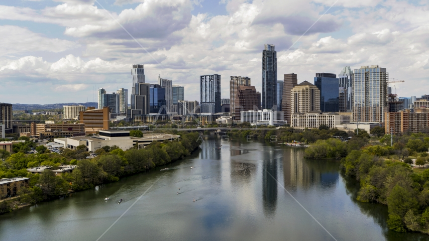A view of the city skyline and Lady Bird Lake in Downtown Austin, Texas Aerial Stock Photos | DXP002_102_0019