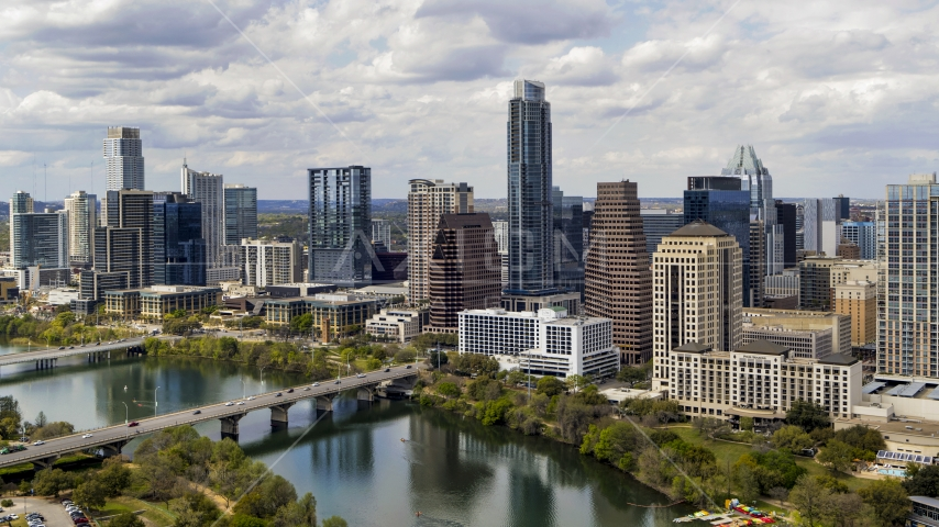 Tall skyscrapers in the city skyline by bridges and Lady Bird Lake, Downtown Austin, Texas Aerial Stock Photo DXP002_102_0021 | Axiom Images