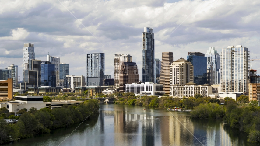 Lady Bird Lake and skyscrapers in Downtown Austin, Texas Aerial Stock Photos | DXP002_103_0001