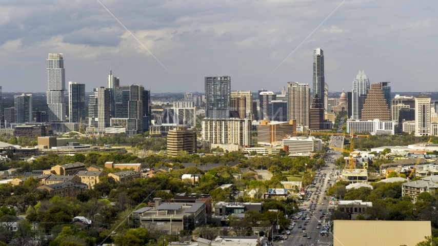 Congress Avenue and a view of the city's skyline in Downtown Austin, Texas Aerial Stock Photos | DXP002_103_0012