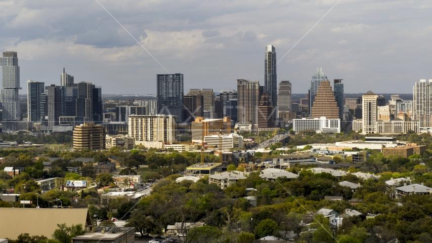 The city's skyline on a cloudy day, Downtown Austin, Texas Aerial Stock Photos | DXP002_103_0013