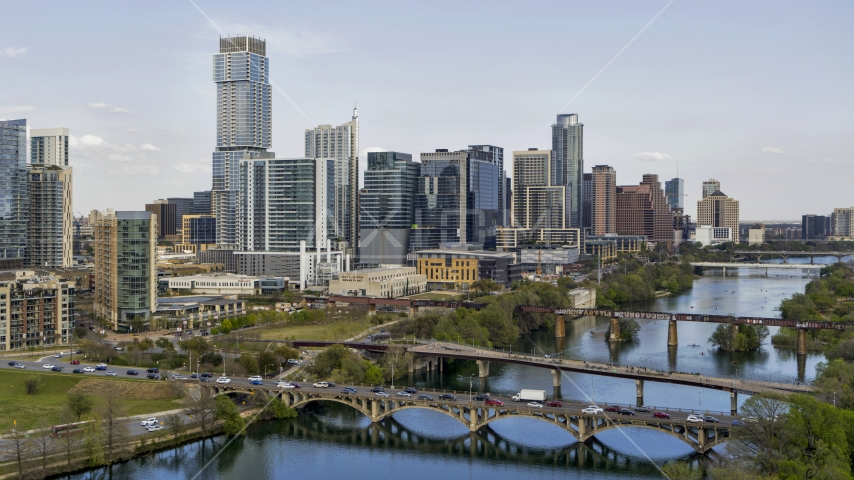 Waterfront skyscrapers by bridges spanning Lady Bird Lake, Downtown Austin, Texas Aerial Stock Photo DXP002_104_0004 | Axiom Images