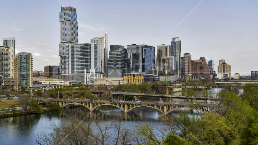 Bridges over Lady Bird Lake near waterfront skyscrapers, Downtown Austin, Texas Aerial Stock Photos | DXP002_104_0005