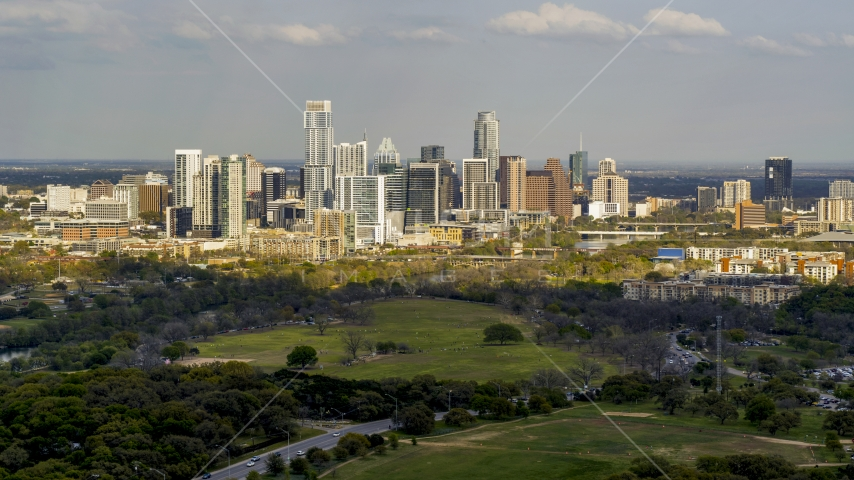 A wide view of city skyline by Lady Bird Lake, Downtown Austin, Texas Aerial Stock Photos | DXP002_104_0007