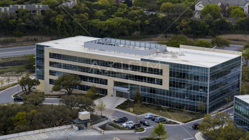 A view of a modern office building in Austin, Texas Aerial Stock Photo DXP002_104_0010 | Axiom Images