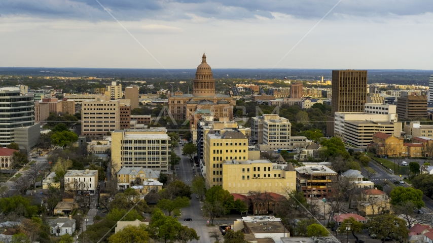 The Texas State Capitol building at sunset in Downtown Austin, Texas Aerial Stock Photos | DXP002_104_0011