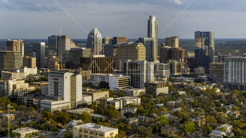 A courthouse, office buildings, and skyscrapers at sunset in Downtown Austin, Texas Aerial Stock Photos   DXP002_104_0016