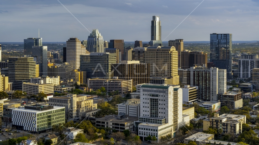 Criminal courthouse near office buildings and skyscrapers at sunset in Downtown Austin, Texas Aerial Stock Photos   DXP002_104_0017